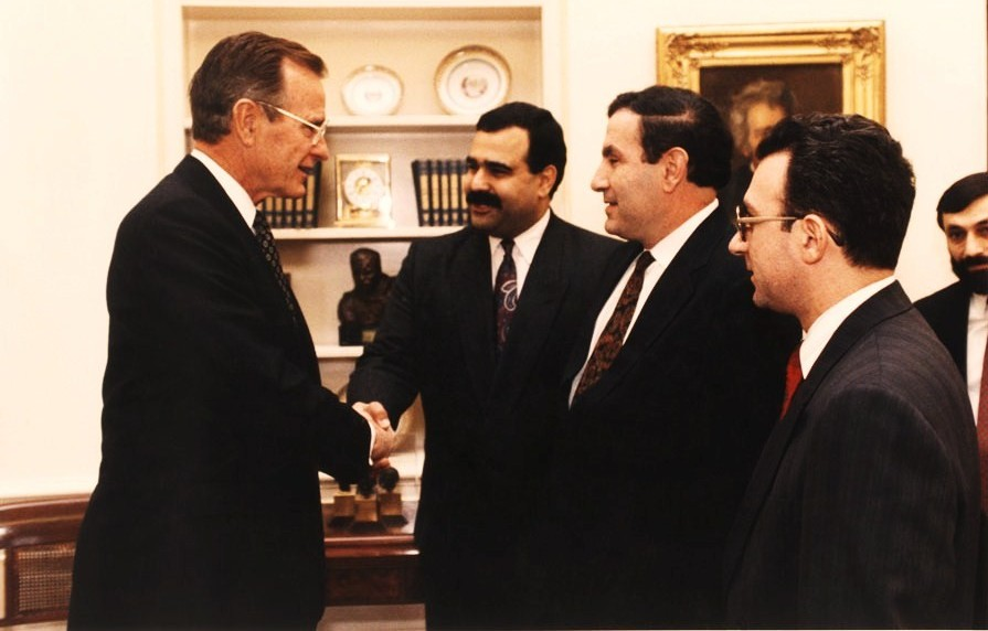 Raffi Hovannisian, then foreign minister of Armenia, shakes hands with U.S. President George W. Bush. (Courtesy of Garin Hovannisian)