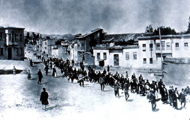 "Turkish officials march Armenians toward the Syrian desert. According to a report relayed by a British member of parliament, quoted in The New York Times in August 1915, ""the roads and the Euphrates are strewn with corpses of exiles, and those who survive are doomed to certain death. ... It is a plan to exterminate the whole Armenian people."" (AP)"